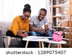 young african couple sitting on ... | Shutterstock . vector #1289075407