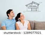 smiling young couple sitting on ... | Shutterstock . vector #1289077021