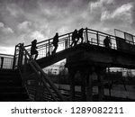 people go over the bridge to...   Shutterstock . vector #1289082211