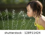 toddler drinking from the water ... | Shutterstock . vector #128911424