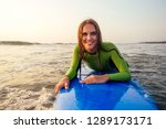 active women with surf board... | Shutterstock . vector #1289173171