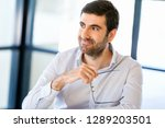 pensive businessman at office | Shutterstock . vector #1289203501