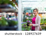 Young Woman Buying Flowers At ...