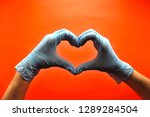 hands in medical latex gloves.... | Shutterstock . vector #1289284504