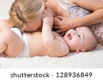 mother playing her baby boy | Shutterstock . vector #128936849