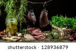 Richly filled farmhouse table with fresh ham - stock photo