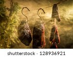 Hanging ham in the smokehouse - stock photo