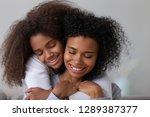 sweet teenage daughter hug... | Shutterstock . vector #1289387377