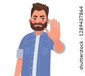 serious man shows stop gesture. ... | Shutterstock .eps vector #1289437864