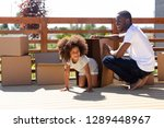 happy african dad and cute kid... | Shutterstock . vector #1289448967