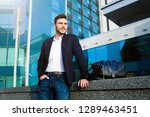 handsome young businessman with ...   Shutterstock . vector #1289463451
