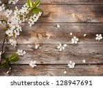 Stock photo flowers on wooden background 128947691