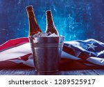 two bottles of beer in an ice... | Shutterstock . vector #1289525917