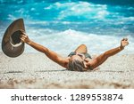 a young woman relaxing on the... | Shutterstock . vector #1289553874