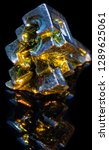 Small photo of Synthetic iridescent stone bismuth macro on black background isolated
