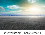 empty asphalt road and city...   Shutterstock . vector #1289639341