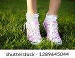 pink female sneakers on... | Shutterstock . vector #1289645044