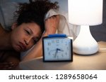 tired black woman suffering... | Shutterstock . vector #1289658064