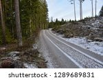 winding gravel road through the ... | Shutterstock . vector #1289689831