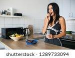 attractive smiling woman in...   Shutterstock . vector #1289733094