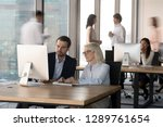 colleagues employees working... | Shutterstock . vector #1289761654