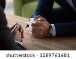 clasped male hands of two... | Shutterstock . vector #1289761681