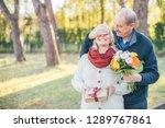 happy elderly man gives his...   Shutterstock . vector #1289767861