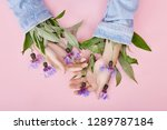 hands and spring flowers are on ... | Shutterstock . vector #1289787184