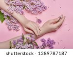 hands and spring flowers are on ... | Shutterstock . vector #1289787187