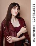 sexy brunette in leather jacket ...   Shutterstock . vector #1289818891