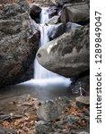 beautiful forest waterfall... | Shutterstock . vector #1289849047