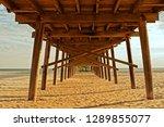 Under The Boardwalk Of An...