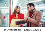 couple in shopping mall. man... | Shutterstock . vector #1289862211