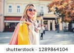 woman in shopping. smiling... | Shutterstock . vector #1289864104