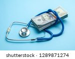 stack of cash dollars and... | Shutterstock . vector #1289871274