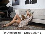 beautiful blonde woman sitting... | Shutterstock . vector #1289920741
