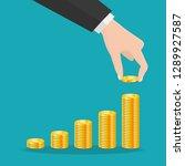 buisness man hand hold gold... | Shutterstock .eps vector #1289927587