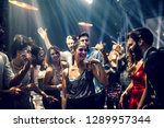 Stock photo group of people dancing in the club 1289957344
