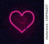 neon love heart on brick wall.... | Shutterstock .eps vector #1289966257