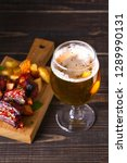 glass of beer and grilled pork... | Shutterstock . vector #1289990131
