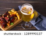 glass of beer and grilled pork... | Shutterstock . vector #1289990137