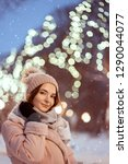 winter portrait of smiling... | Shutterstock . vector #1290044077