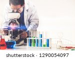 man scientist working in... | Shutterstock . vector #1290054097