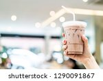close up hand holding iced...   Shutterstock . vector #1290091867