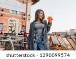 blissful woman in casual attire ... | Shutterstock . vector #1290099574