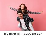 excited girl in checkered shirt ... | Shutterstock . vector #1290105187