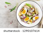 Stock photo traditional salad of salted herring fillet fresh apples red onion and eggs kosher food 1290107614