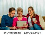 grandmother using tablet with... | Shutterstock . vector #1290182494