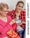 granddaughter giving... | Shutterstock . vector #1290182497