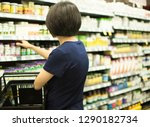 woman shopping at grocery... | Shutterstock . vector #1290182734